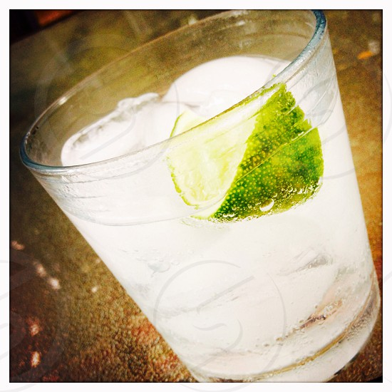 Vodka tonic with lime  photo