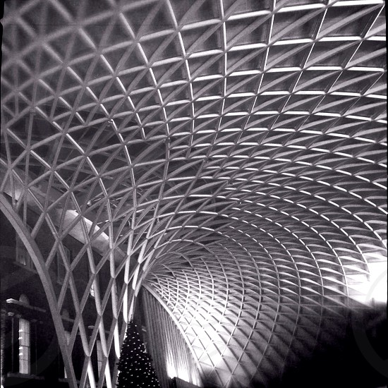 Metal roof above the concourse at Kings Cross Station London England. The roof was designed by architects John McAslan and Partners.  photo