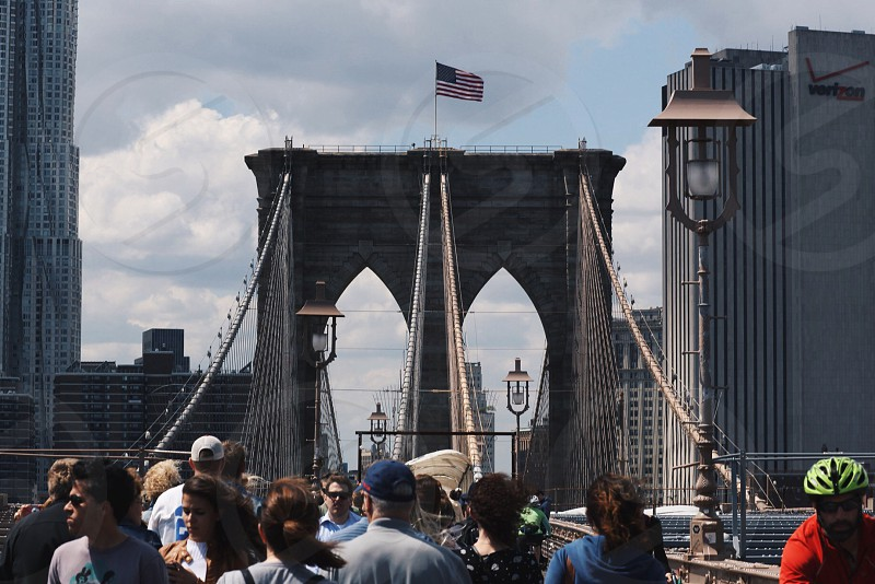 view of people on the brooklyn bridge photo