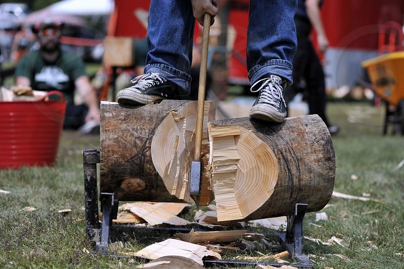 Lumberjack chopping log with wood grain showing photo