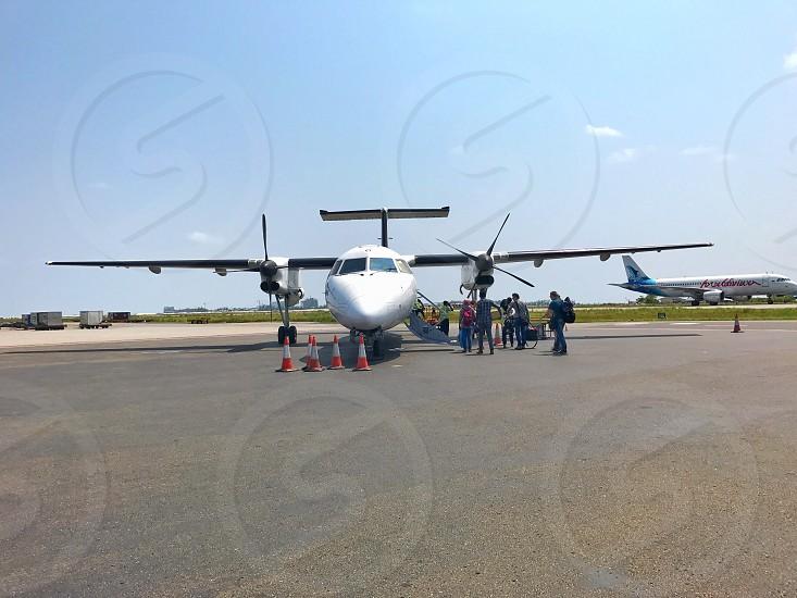 Passengers on-boarding airplane airporttravel photo