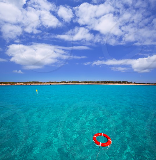 Formentera Illetes Illetas with round buoy view from sea at Balearic Islands photo