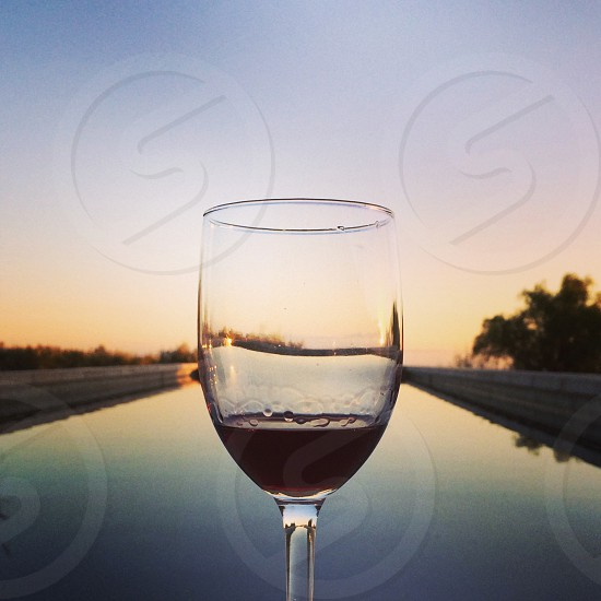 Wine glass reflecting at sunset. Santa Barbara CA photo