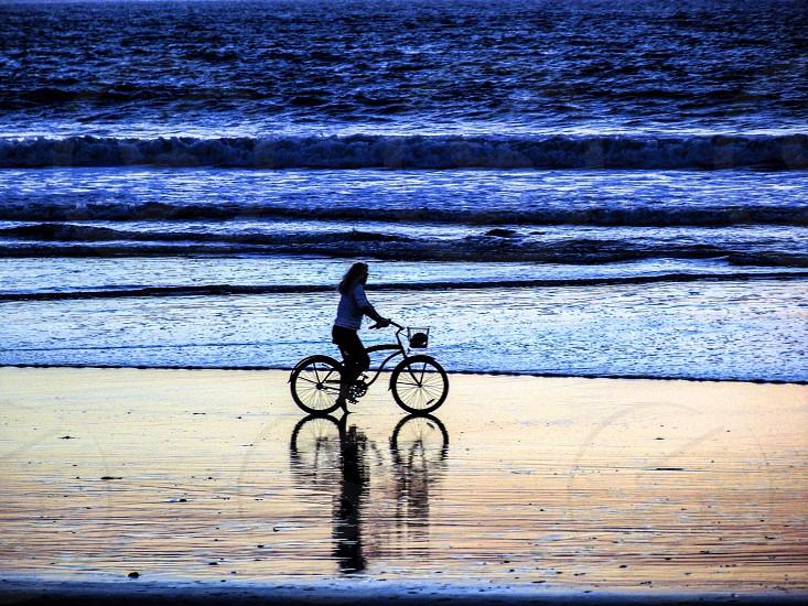 Bike ride riding biking beach woman nature ocean water landscape California sunset hobby photo