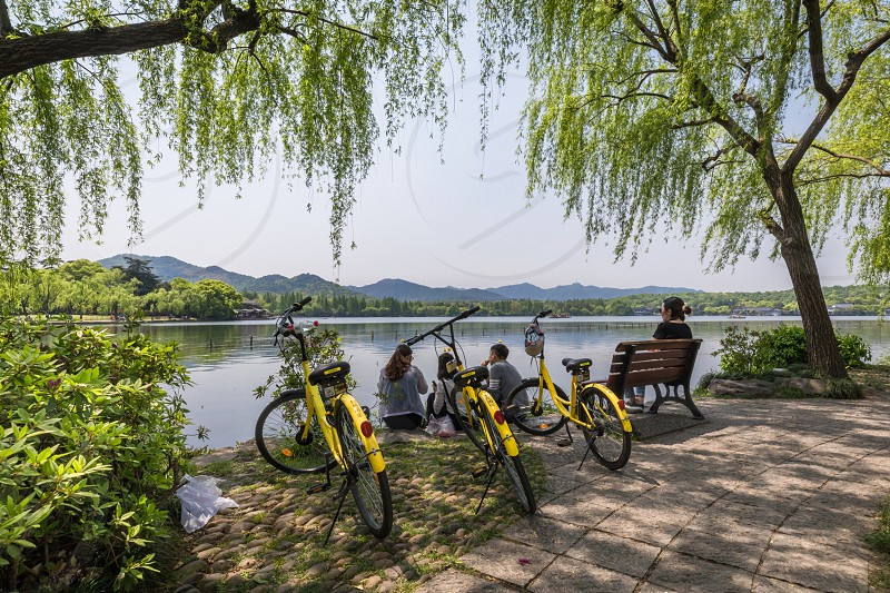 China Hangzhou West lake bycicle nature water mountain reflection spring outdoor photo