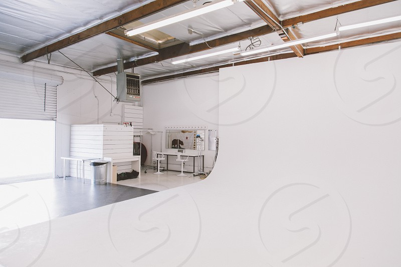 white room with wood beams photo