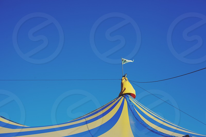 Blue and yellow tent festival sky big tent photo