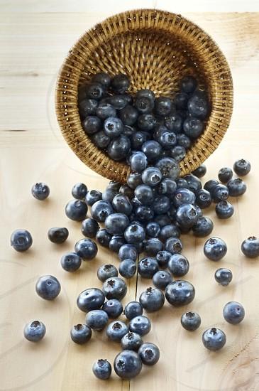 blueberries basket spill wood vertical fruit berries photo