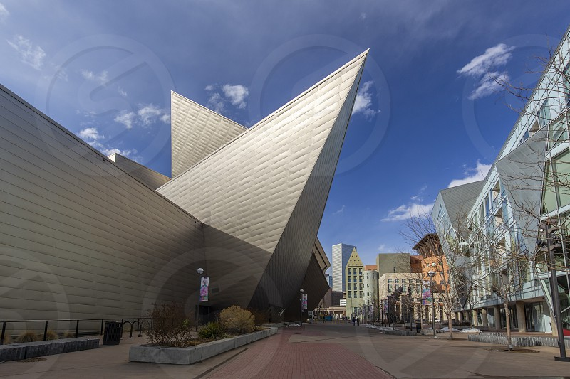 Soaring angular roof of Denver Art Museum from plaza looking toward Denver Public Library and Civic Center Park.  photo