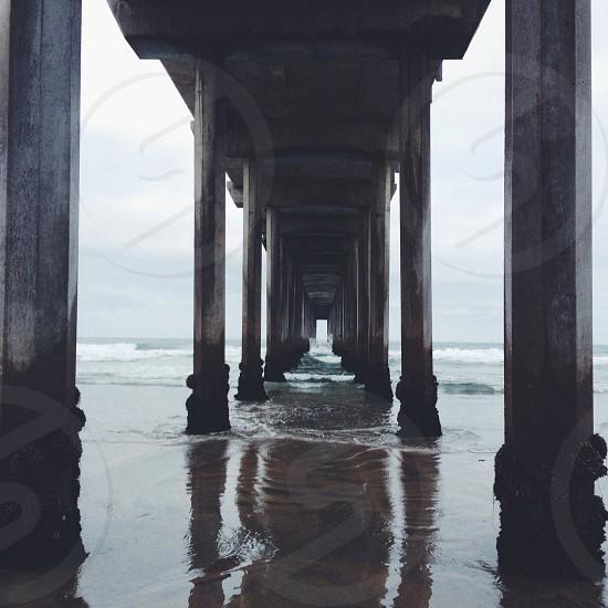 under the beach bridge post photography photo