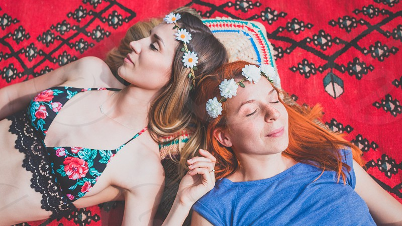 Two hippie girlfriends enjoying in the countryside photo