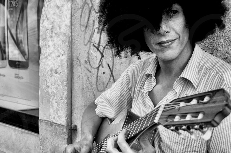 woman with curly hair holding guitar photo