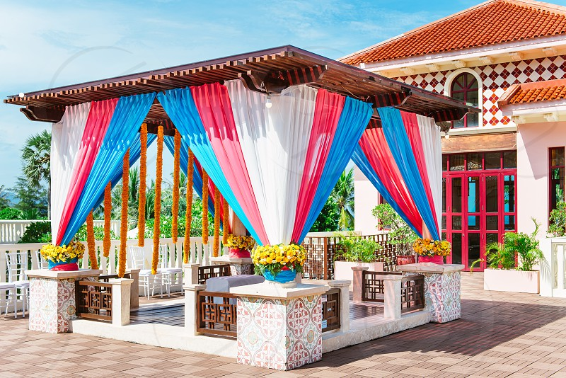 The colorful decoration of indian wedding venue for thread ceremony. photo