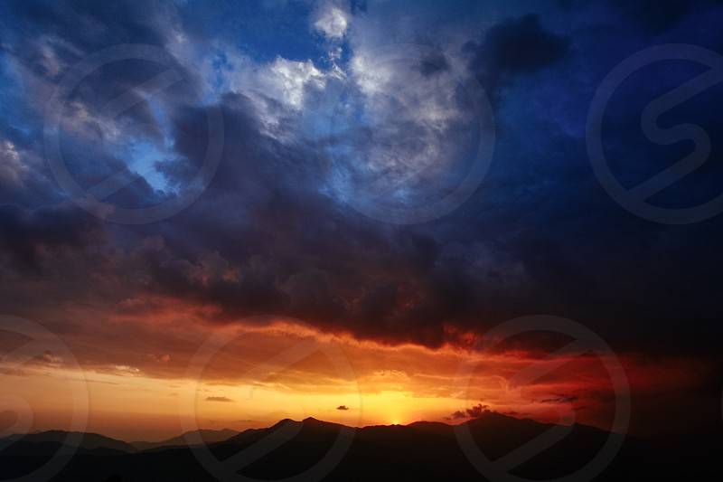 Dramatic sky over the mountains photo