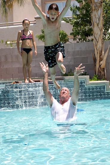 Flight by Grandpa swimming flying water summer fun grandpa grandchildren  photo