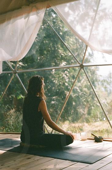 Meditating in the soft morning light. Shot on 35mm film. photo