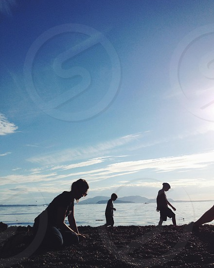 3 persons silhouette under blue clear sky photo