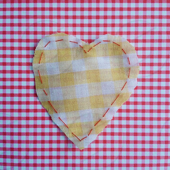 red and white checked patterned cloth photo