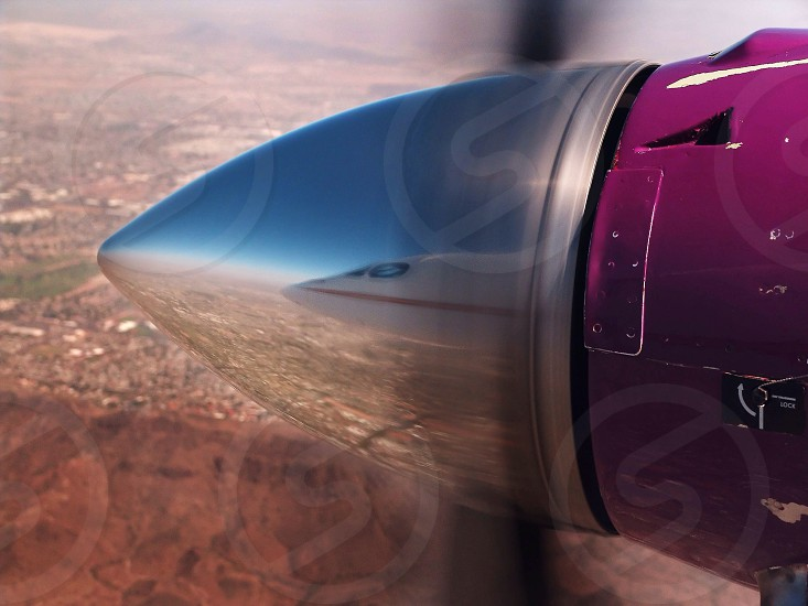 Reflection of plane's cockpit in propellor cowling photo