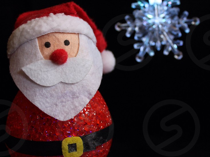 red white santa figure and snow flake photo