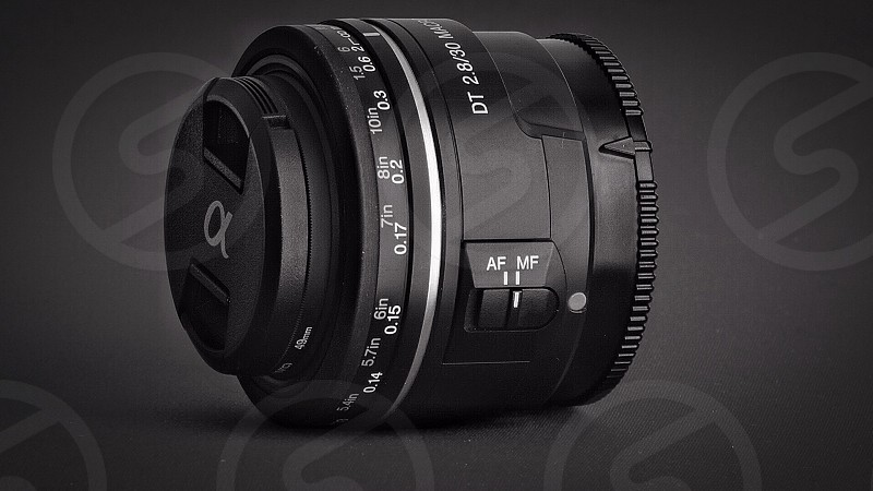 photography of alpha black camera lens in dim light effect photo