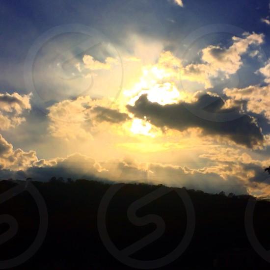 Sky clouds sun sun rays photo