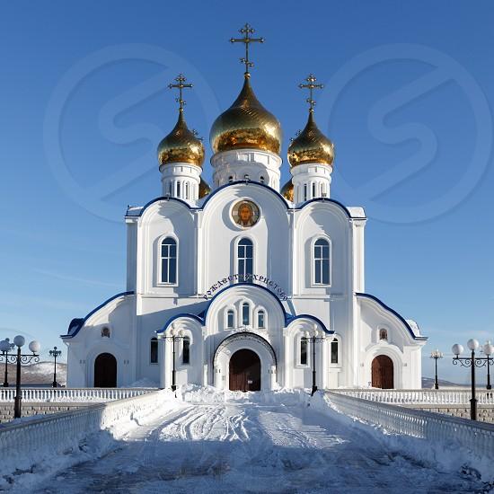 PETROPAVLOVSK KAMCHATSKY CITY KAMCHATKA PENINSULA RUSSIAN FAR EAST - JAN 6 2018: Building of Holy Trinity Orthodox Cathedral of Petropavlovsk Kamchatka Peninsula Diocese of Russian Orthodox Church photo