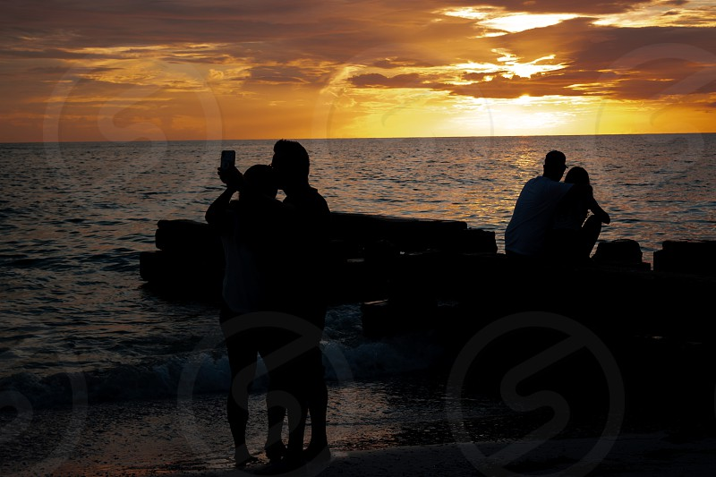 Selfies at Sunset on Beach photo