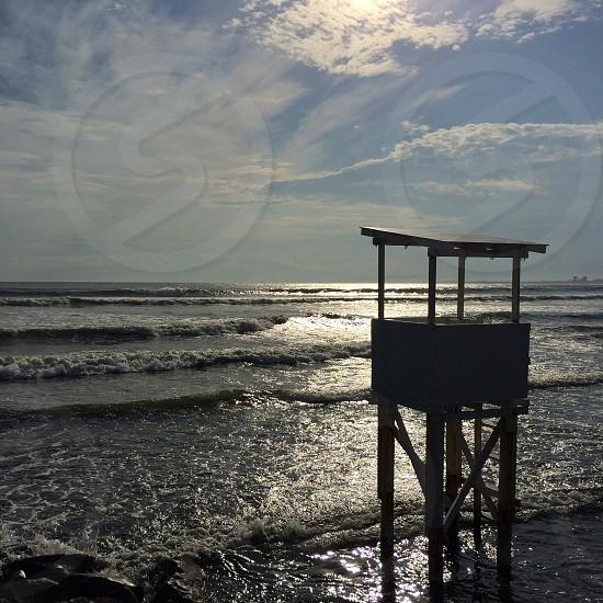 lifeguard station tower on beach photo