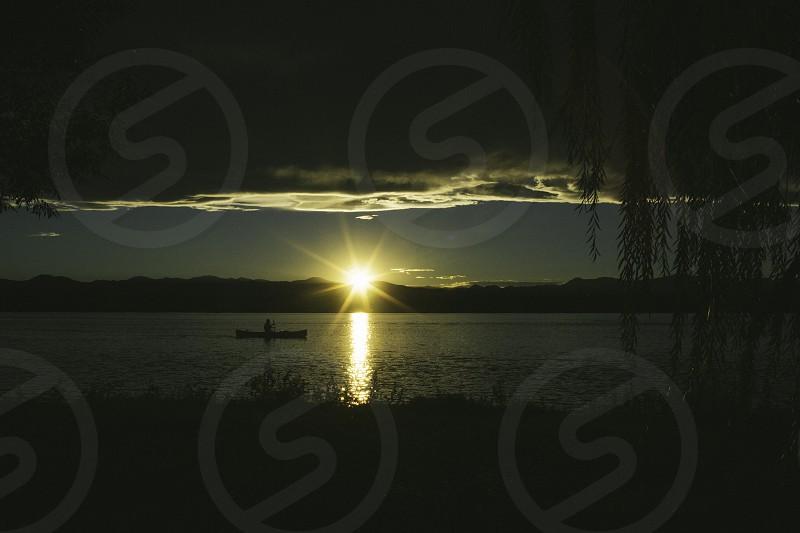 Canoe into the sunset. photo