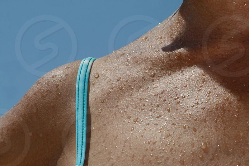 blue strap on human skin photo
