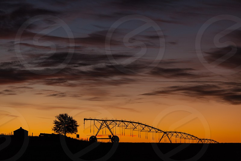 Early morning photograph of irrigation system in Oklahoma. Agriculture. Morning. photo