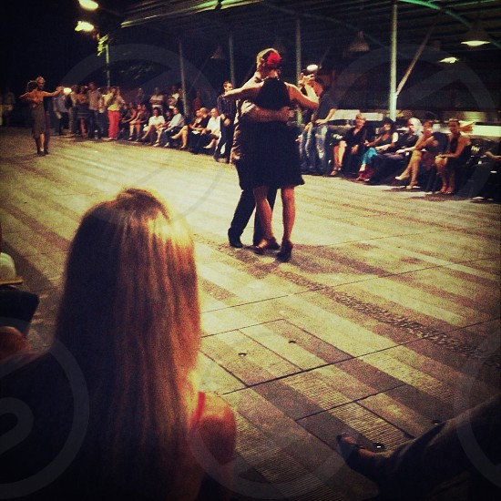 man and woman dancing on brown wooden floor photo