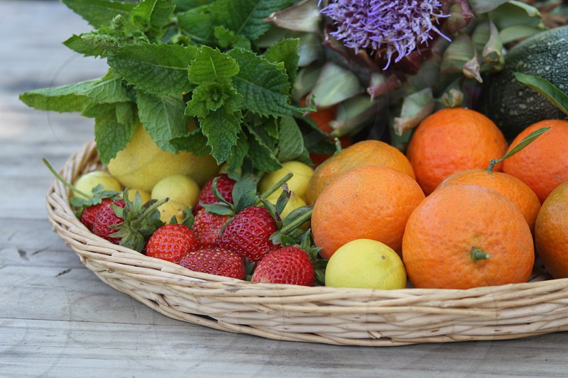 oranges and strawberries in basket photo