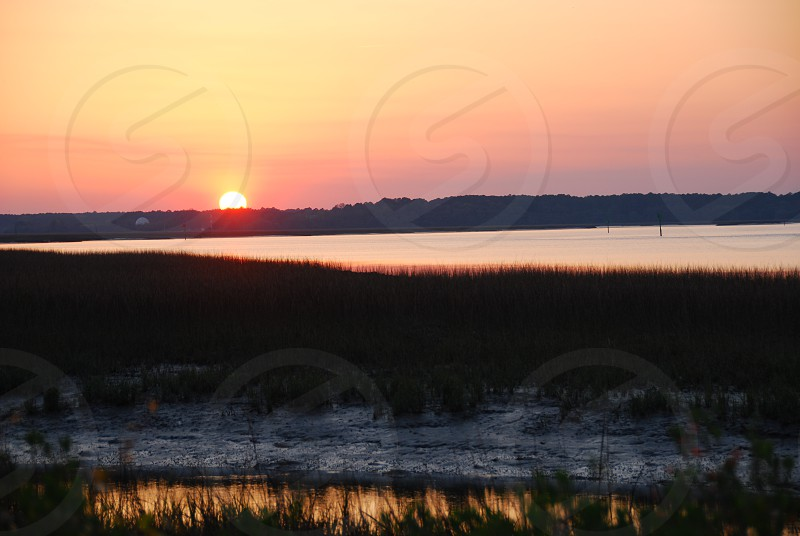 Sunset over wetlands South Carolina photo