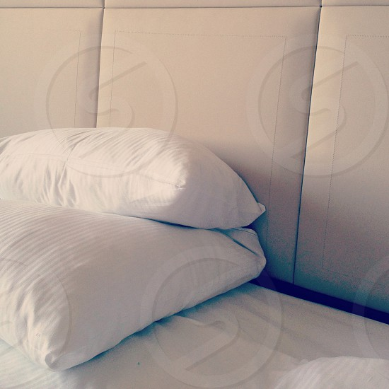 White pillows on a hotel bed | sleep minimalism white neutral photo