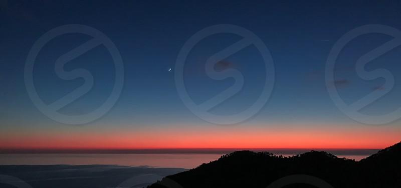 Sunset  sky  sun  moon  colors  sea  hills  rock photo