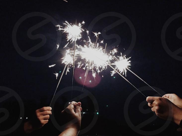 person holding sparkler photo