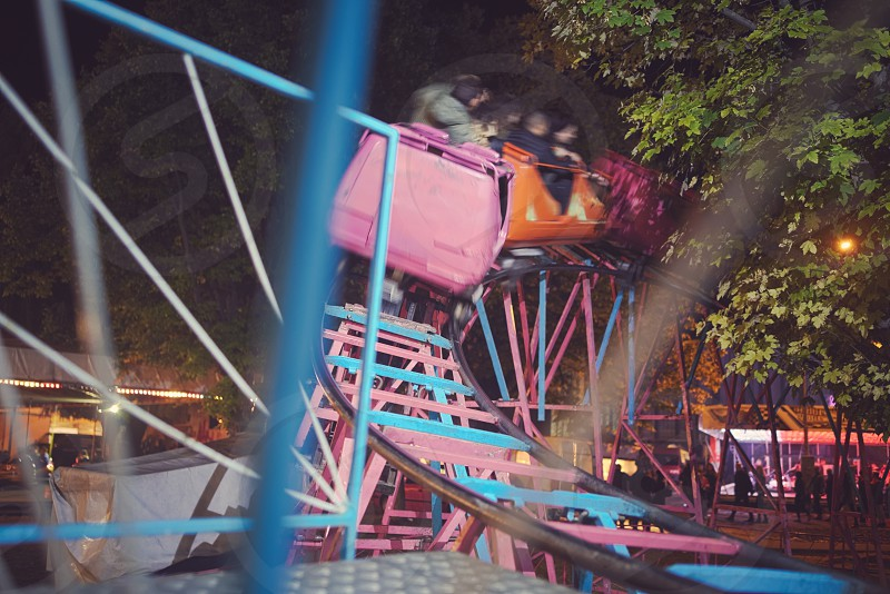 Fast Moving Roller Coaster at Town Fair photo