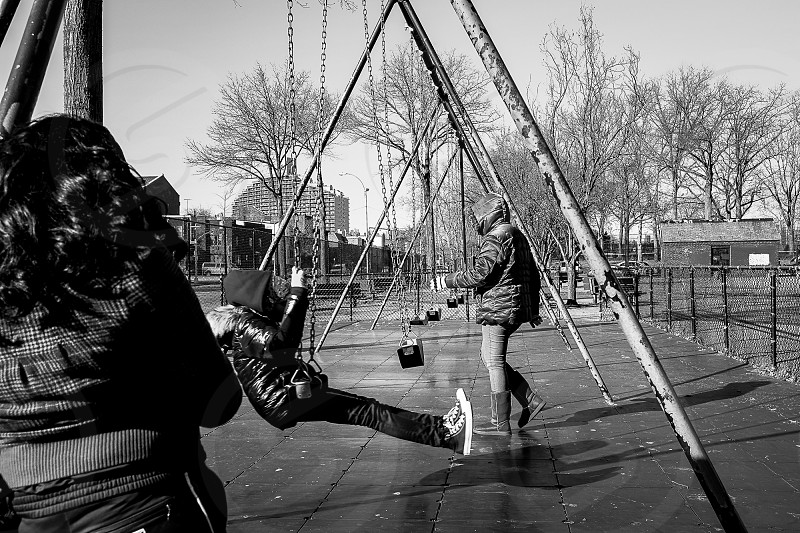 Urban Winter kids playground Street photography Black and white Trees Cold Documentary  photo