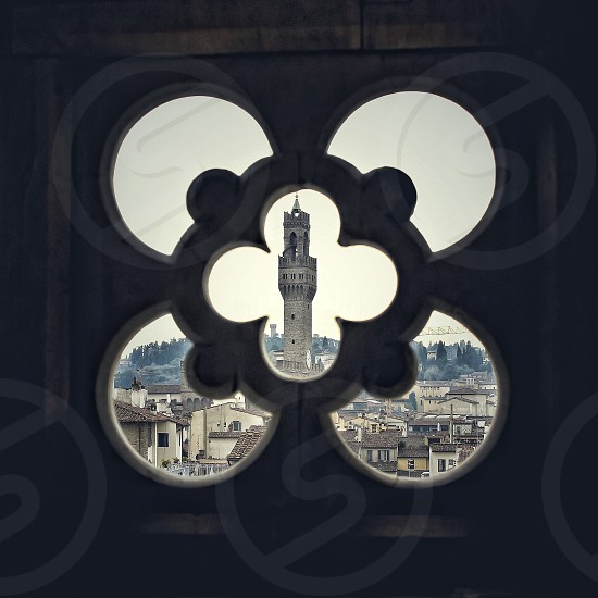 View through a carved concrete wall at the Palazzo Vecchio in Florence Italy photo
