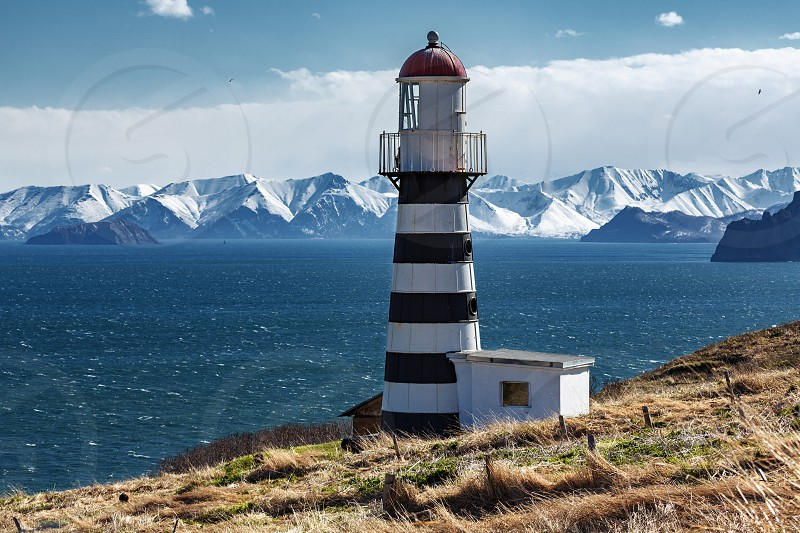 Petropavlovsky Lighthouse (founded in 1850) is located on Mayachny Cape on Kamchatka Peninsula on shore of picturesque Avacha Gulf in the Pacific Ocean in vicinity of Petropavlovsk-Kamchatsky City. photo