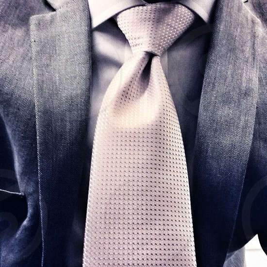men's grey suit and silver tie photo