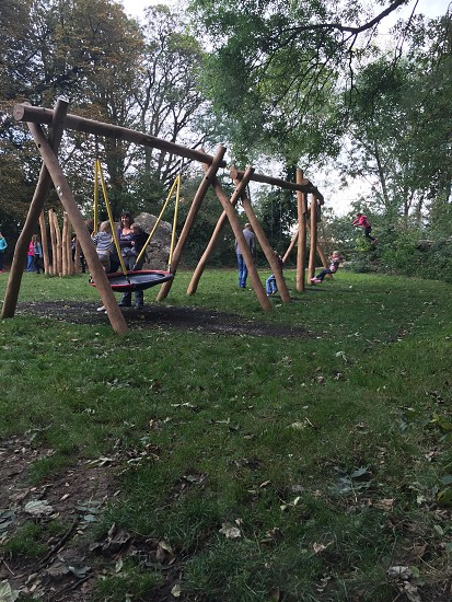 kids playing on the swing photo