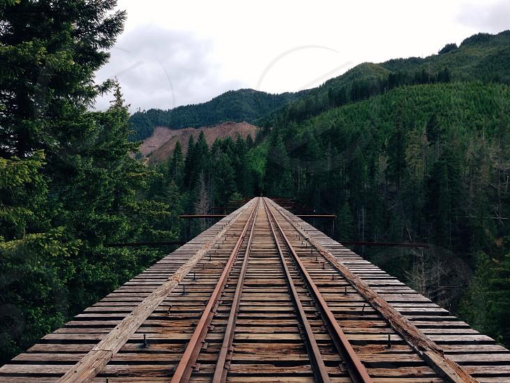 railroad tracks on wooden bridge photo