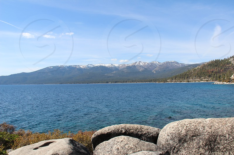 Lake Tahoe with snow capped Sierra Nevada in background. photo