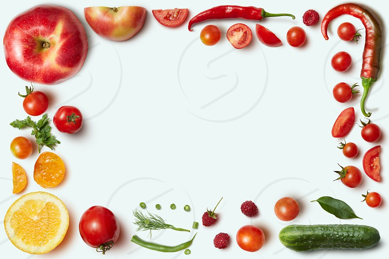 Frame of vegetables and fruits on white background. Unusual place for text about cooking nutrition healthy lifestyles Italian food photo