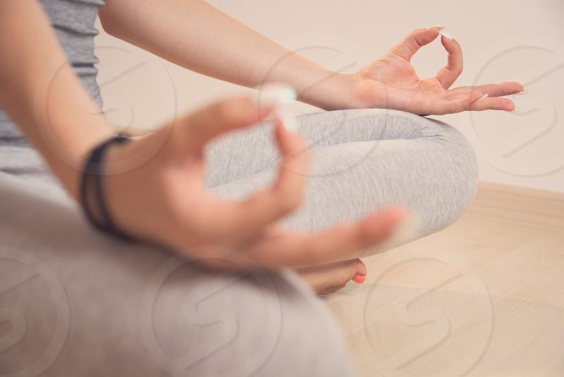 Teen Girl Meditating in Turkish Sitting Position Closeup photo