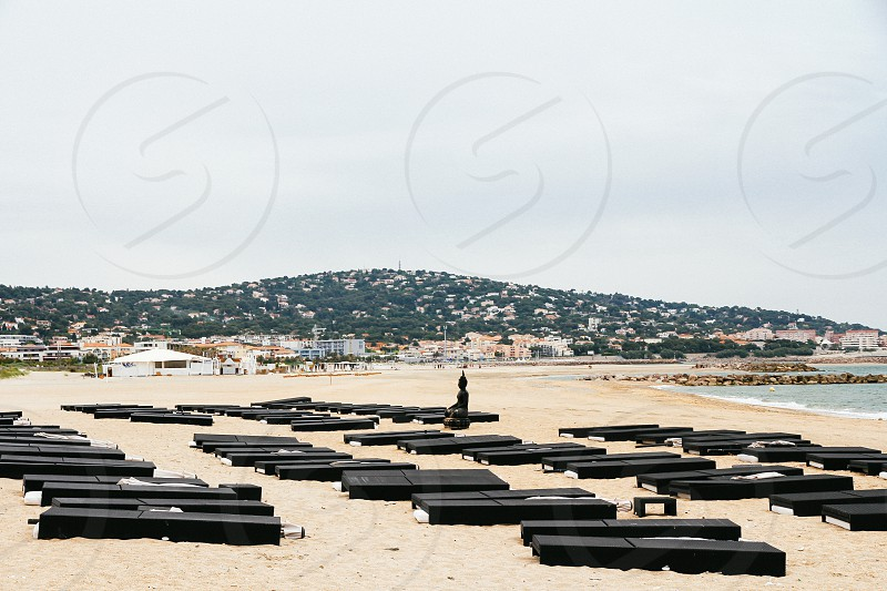Empty sun bathing beds overcast day beach Sète Languedoc-Roussillon France photo