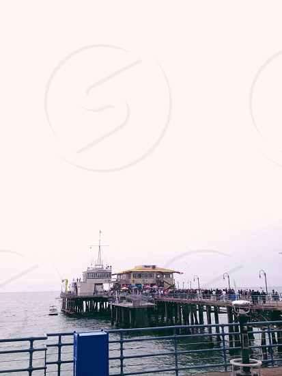 people on sea dock photo